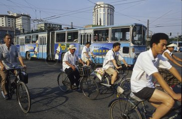 Bicycles and streetcar in traffic Beijing China
