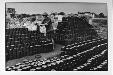 Man manufacturer of small charcoal bricks Vietnam