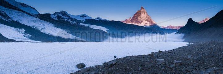 Panoramic view of a trekker and Matterhorn Switzerland