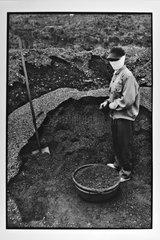 Woman miner from coal Ha Tu Vietnam