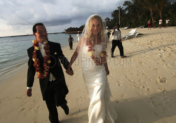 Olhuveli Resort  Adrian Godwin from England and Elvira Andreeva from Russian during a mock wedding ceremony. By law is forbidden for foreigners to marry on the Maldives.