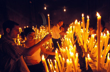 El Rocio pilgrims burning candles in the church of the holy virgin