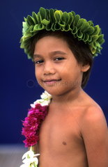 Young boy colorful dancer in Tahiti in French Polynesia in the South Pacific Rim