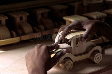Poor children learn how to produce wooden toys in order to generate income  Brazil. Craftmanship  craft  wooden car  social work  community organizing  sustainable work  income generator project.