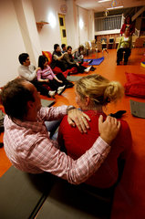 Amsterdam  a group of pregnant women is taking part in a yoga course together with their husbands and fathers to be.