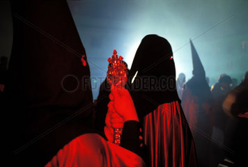 Jerez de la Frontera during the holy week of Eastern hooded processions pass through the night