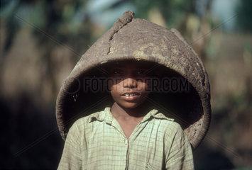 HEPAL : Near the town of Meghauli  in the Terai. Tharu boy.