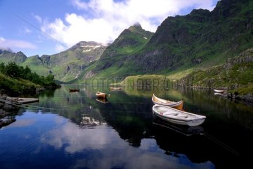 Reflet and boats on the water Lofoten Islands Norway