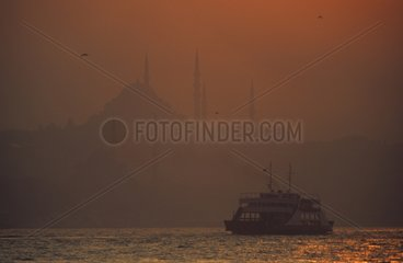 Crossing of Bosphorus by ferry at sunset Turkey