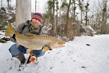 Presentation of a female trout in wedding dress