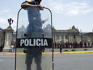 Police watching near the presidential palace Lima