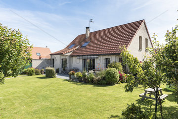Brick house and garden in a pavillonnaire area in summer  Pas de Calais  France