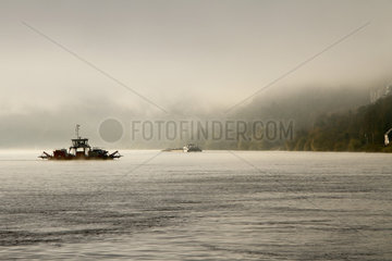 Ferry in the fog to cross the Seine at Heurteauville  Normandy  France