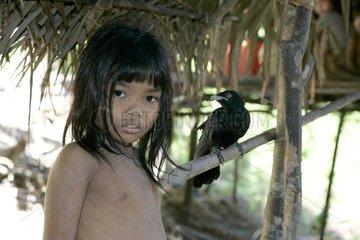 Girl and bird tamed Tau't Batu Palawan Philippines