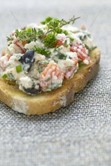 Bruschetta with Brousse of ewe and olives black France