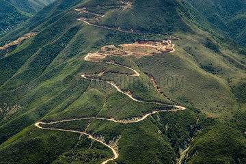 Track of mining in the mountain. Exploitation of nickel. Town of Poya. New Caledonia.