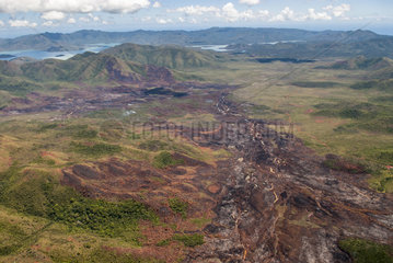 Fire in humid wetland in mining scrub  Pernod Creek River  Yate Township  New Caledonia.