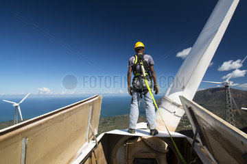 Man inspecting a wind turbine. New Caledonia.