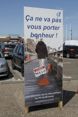 Information panel on the price of fines for the lack of respect for cleanliness in town at Treport  Normandy  France