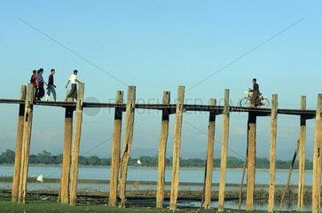 People walking on U Bein teck bridge Burma