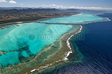 Aerial view on lagoon and reef of the west coast. Lagoon of Poe. West Coastal Area World Heritage Site by Unesco. New Caledonia.