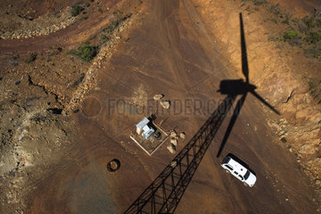 Shadow of a wind turbine on the ground. New Caledonia.