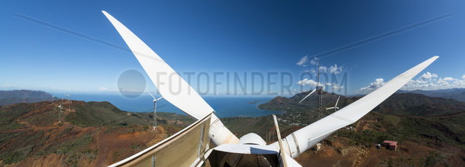 Panoramic view of wind turbine blades in New Caledonia.