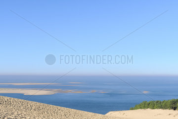 General view of Banc d'Arguin from the Pilat dune  located on the edge of the forest of the Landes de Gascogne on the Silver Coast at the entrance to the Arcachon basin. The passes and bottom-bottoms (letters) of the basin are in perpetual evolution  Pyla-sur-Mer  Aquitaine  France