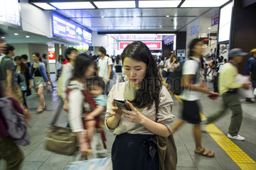 women on mobile phone in subway