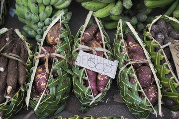 Baskets of sweet potato (Ipomea batatas) on the market of Port Vila  Efate Island. Vanuatu.