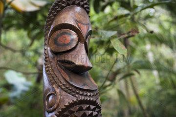 Carved wood in a garden  Efate Island  Vanuatu.