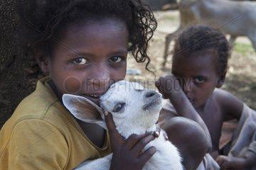 Girl holding a goat - Lake Awasa Ethiopia