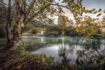 Autumn colors in the wellspring  La Santissima  Polcenigo  Pordenone  Italy