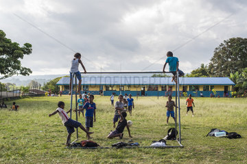 Children playing football in a school  Efate Island  Vanuatu
