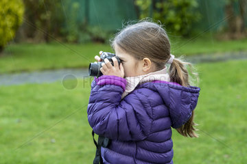 Girl taking a picture in winter  France