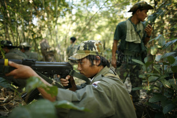 A KNLA soldier takes aim in the jungle around La Per Her. In Myanmar (Burma)  thousands of people have settled near the border as a result of oppression in their homeland. Around 200 Burmese displaced people have settled in La Per Her  a village on the Bu