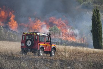 Fire engine near a fire scrubland - France