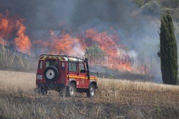 Fire engine near a fire scrubland - France