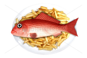 Plastic fish food. Concept image of a fish served on a plate with other real food elements. Plastic fish and ships. We are eating plastic on our seafood. Contaminated fish and shellfish have been found everywhere from Europe  Canada and Brazil to China ? and plastic-eating fish are now showing up in supermarkets. While most plastic has been found in the guts of fish  and would therefore be removed before eating  some studies have warned that microplastics  particularly at the nanoscale  could transfer from the guts to the meat (and  of course  we eat some species of small fish and shellfish whole). There is growing concern about toxins leaching ? laboratory tests have shown that chemicals associated with microplastics can concentrate in the tissues of marine animals. Some commercially important species have seen the majority of their population affected. It confirmed that contamination has been recorded in tens of thousands of organisms and more than 100 species. Last year  the European Food Safety Authority called for urgent research  citing increasing concern for human health and food safety ?given the potential for microplastic pollution in edible tissues of commercial fish?. Portugal