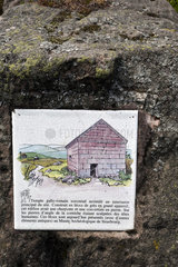 Rock with information panel on Gallo-Roman temple  mountain ash  top of Donon  Hautes Vosges  Bas Rhin  France
