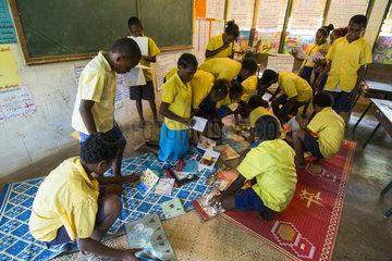 Children reading in a school  Efate Island  Vanuatu