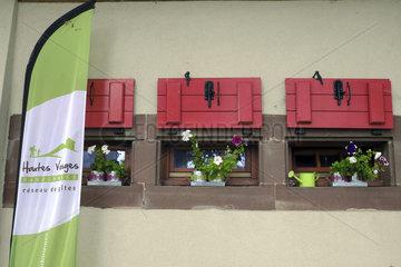Pennant and logo Gites network  Belacker farm  inn  gite  Belacker farm  Rossberg massif  Hautes Vosges  Haut Rhin  France
