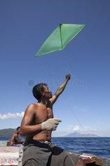 Man fishing with kite - Pantar island Alor Indonesia