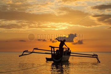 Fisherman fishing at the sunset - Kokar Alor Indonesia