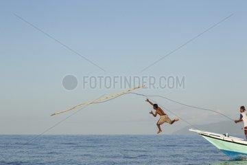 Fisherman throwing harpoon on Manta ray - Solor Indonesia