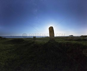 Standing stone hiding the moon in district - Britain France