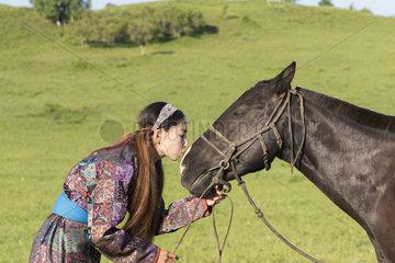 Mongolian woman with her horse  Bashang Grassland  Zhangjiakou  Hebei Province  Inner Mongolia  China