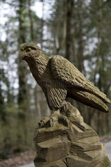 Raptor sculpture  trails of Faines and Enchanted Forest  wooden sculpture  forest  Boncourt  canton of Jura  Switzerland