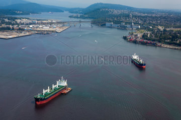 Cargo ships at vancouver harbor