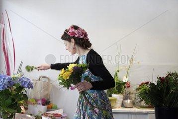 Florist preparing a bouquet in her shop